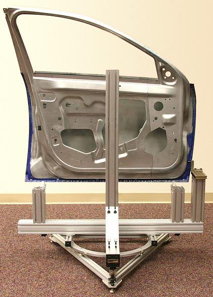 Universal door fixture rotating omnistructures inc for Omni garage door